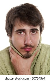Portrait of young man in  green pullover suffering from  cold