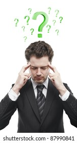 Portrait of a young man with green question marks above his head.Conceptual image of a open minded man. Isolated on a white background