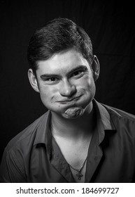 portrait of a young man grimacing