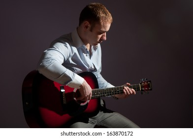 Portrait of young man with guitar