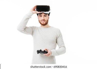 b4e8ef0a8bb Portrait of young man happily looking in camera with virtual reality  glasses on his head and