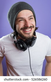 portrait of young man with headphones against color background