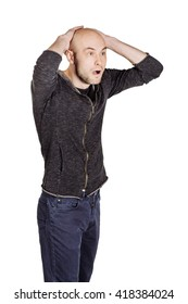 Portrait of a young man hiding his head with the hands. human emotion expression and lifestyle concept. image on a white studio background.