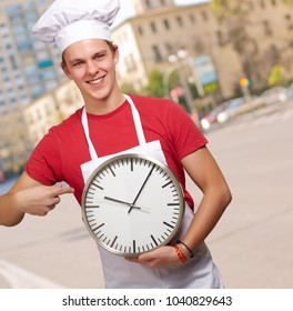 Portrait Of A Young Man Holding A Clock, Outdoor