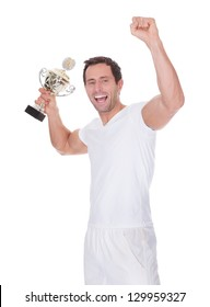 Portrait Of Young Man Holding Trophy Isolated On White Background