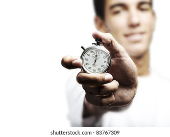 portrait of young man holding a vintage stopwatch against a white background
