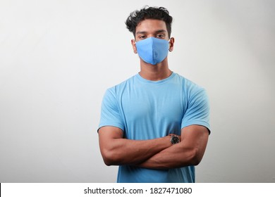 Portrait of a young man of Indian origin wearing face mask