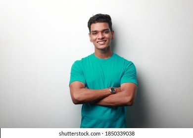 Portrait of a young man of Indian origin with a smiling face