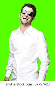 portrait of young man laughing against a removable chroma key background