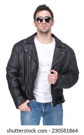 Portrait of a young man in a leather jacket and sunglasses, isolated on white background.