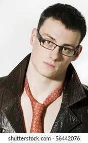 Portrait of young man in a leather jacket and glasses
