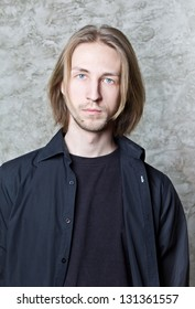 Portrait of young man with long blond hair