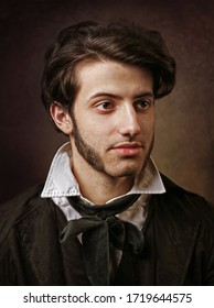 Portrait of young man with long sideburns.