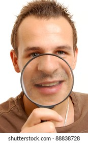 portrait of a young man looking through loupe