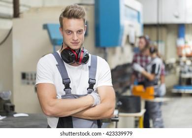 Portrait of young man metallurgist