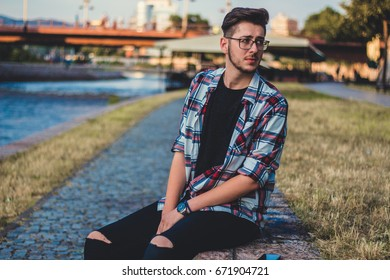 Portrait of young man near the river.