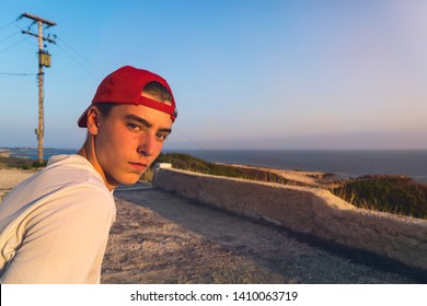 portrait of a young man near the sea