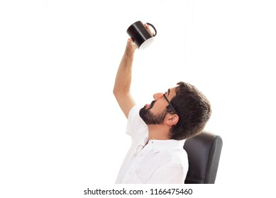 Portrait of a young man in the officce holding an empty coffee cup on white isolated background