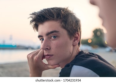 Portrait of a young man on the beach in the evening sun