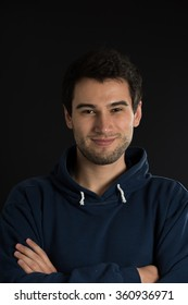 portrait of young man on the black background