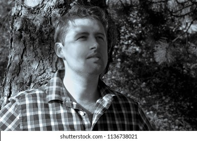 Portrait of young man outdoors  . grass on the background