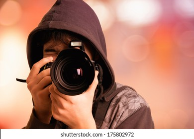 Portrait of young man photographer with camera. Paparazzi pictures of stars