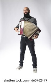 Portrait of Young Man Playing Accordian