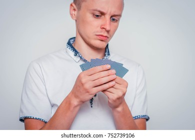 portrait of young man with playing cards