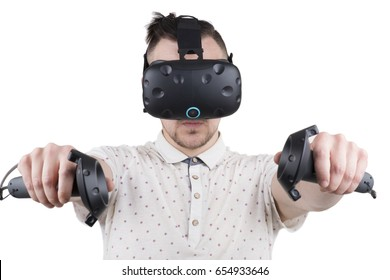 portrait of young man playing virtual reality vr console isolated on white