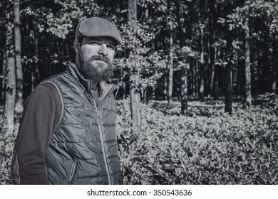 Portrait of a young man posing in the forest