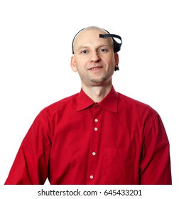 Portrait of young man in red shirt with EEG (electroencephalography) headset on head. Isolated on white background.