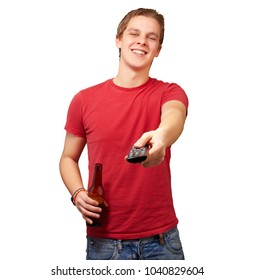 portrait of a young man with remote control on white background