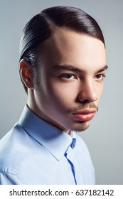 Portrait of young man with retro classic hairstyle. studio shot.