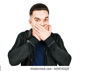 Portrait of young man scared and closes mouth hands. Isolated on white.