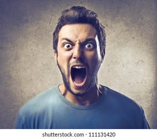 Portrait of a young man screaming