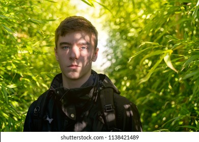 portrait of a young man with shadows of a bamboo forest on his face