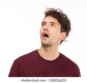 Portrait of young man with shocked facial expression