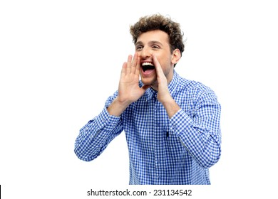 Portrait of a young man shouting loud with hands on the mouth