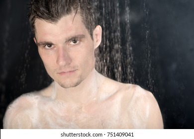 Portrait of young man in shower