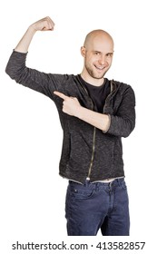 Portrait of a young man showing muscle. human emotion expression and lifestyle concept. image on a white studio background.