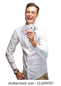 Portrait Of Young Man Showing Poker Cards On White Background