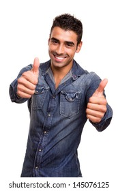 Portrait of a young man showing thumbs up