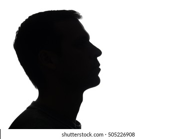 Portrait of a young man, side view - dark silhouette