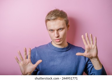 Portrait of a young man with sign alt as a concept to stop in business