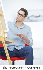 portrait of young man sitting