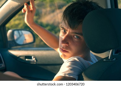 portrait of a young man sitting in a car