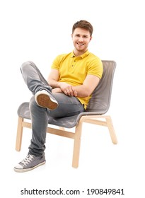 Portrait of a young man sitting on a armchair
