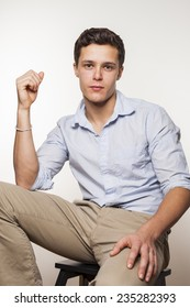 Portrait of young man sitting on chair