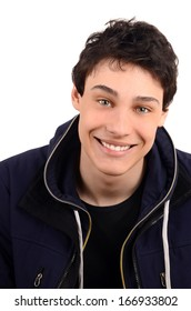 Portrait of a young man smiling. Caucasian handsome man laughing. Guy dressed with winter jacket. Isolated on white background.