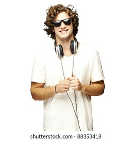 portrait of young man smiling with headphones over white background